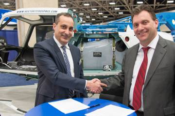 Vector Aerospace v-p of business development for airframe and avionics solutions Elvis Moniz (left) and Astronautics president Chad Cundiff sign an MoU to pursue STCs for the Roadrunner EFI installations in several helicopter models.