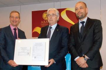 Three men holding certificate