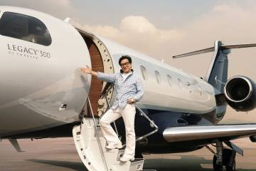 Movie star Jackie Chan with the Legacy 500.