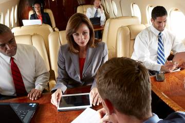 People in aircraft cabin using Gogo's Smart Cabin Systems