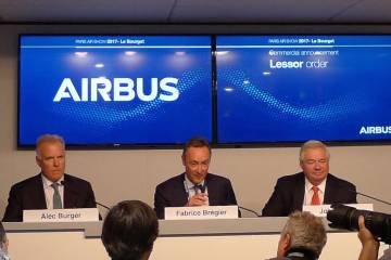 (Left to right) GECAS president and CEO Alec Burger; Airbus president and CEO Fabrice Brégier; and Airbus COO John Leahy outlined details of a large order.