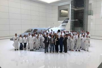 HondaJet team with round-the-world airplane