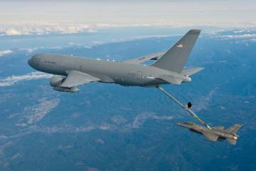 KC-46 refuels an F-16 in flight