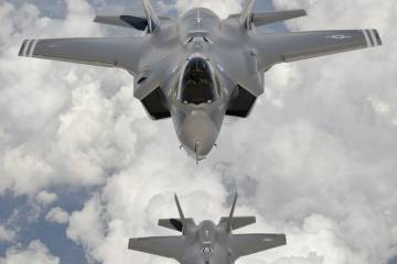 The first two F-35As fly in formation. Flight tests have resumed after a rece