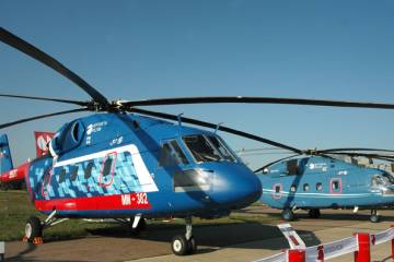 The Russian-powered version of the Mi-38 (left) made its debut at the Moscow