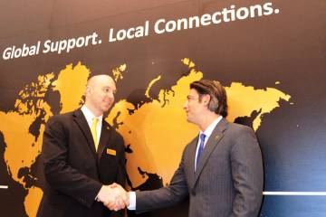 JSSI vice president for strategic planning and business development Kevin Thomas (left) sees Latin America as a key market for the company's per flight hour maintenance programs. Here he is seen being congratulated by CEO Neil Book on signing up the group's 10,000th asset to be covered at the EBACE show in May.
