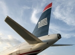 US Airways is locked in an ongoing and increasingly bitter labor dispute with...