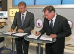 Lufthansa Technik's August Henningsen (left) and Panasonic's Paul Margis ink ...