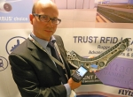 MAINtag President Bruno Lore displays an Airbus A350 armrest panel with a blu...