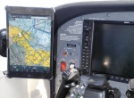 Deohako's iPad mini mounting system lets pilots mount the device on the windshield, shown, or yoke (for some airplanes).  The case can also be used as a kneeboard.