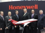 L to r: Chuck Taylor, SyberJet v-p; Ken Snodgrass, Honeywell v-p for integrated platform systems; John Todd, Honeywell v-p for Bombardier and Apex; David Grant, SyberJet president; Mark Fairchild, SyberJet general manager; and Rich Reisberg, SyberJet director of engineering were on hand for the announcement of the planned production restart of the SJ30 twinjet.