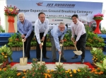 Jet Aviation officials and dignitaries from Singapore's economic development board break ground on the new facility.