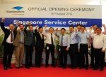 StandardAero employees and Singaporean authorities celebrate the opening of the company's helicopter facility at Seletar Airpark.
