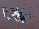 """The Eurocopter X3 technology demonstrator flew at 255 knots in level flight, an unofficial record for a helicopter, on June 7. It also reached 263 knots in a dive. """"It's no exaggeration to say that the X3 is clearly in its element at high speeds,"""" said Hervé Jammayrac, Eurocopter test pilot."""