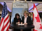 Maria Sastre, President and COO Signature Flight Support signed an agreement with Marilyn Boston, Aviation Manager of Imperial Oil.