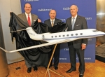 Gulfstream's Mark Burns, president of product support; Scott Neal, vice president of worldwide sales and marketing; and president  Larry Flynn officially unveil the G650ER yesterday at EBACE. (Photo: Mark Wagner)