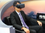 Man in chair using Honeywell's Occulus Rift 3-D display