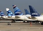 JetBlue Airbus A320s parked at airport