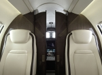 The cabin of Bombardier's light Learjet 75 can now have the look and feel of a much larger aircraft with the new option of a pocket door separating the cockpit and galley from the rest of the cabin. Besides adding privacy, it also reduces noise by up to 8 dB.