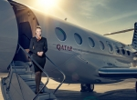 woman on business jet staircase
