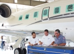 Banyan's Craig Chin, avionics installation lead coordinator (left), reviews the Challenger 604 work order along with Charles Amento, director of maintenance (center), and Curtis Florio, maintenance crew leader.