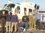 Vector employees and members of the San Bernardino County Sheriff Department pose with the Bell 212 the company modified for the agency.