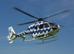 "The distinctive zig-zag livery of this EC135, designed by German artist Rita Weber, was adapted and applied to the helipad on the owner's super-yacht ""Quattronelle."""