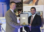 David Davenport, senior vice president, FlightSafety International, with Salem Abaid Al Muzeini, COO of ISS, and after signing the agreement.