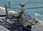 Attack helicopters, including this British AH-64D Apache, are launched from s...