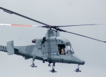 The K-Max is one of two contenders for an unmanned cargo lifting requirement ...