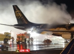 Firefighters douse a blaze on board a UPS DC-8 at Philadelphia International. Li