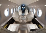 "Cessna's new Citation Latitude is available for inspection on the NBAA static display line, featuring this production interior. With its flat floor and generously sized cockpit layout, the new-design Latitude is one product of the company's creative engineering team. ""They like designing stuff, and we've got to keep them busy,"" said Textron Aviation president and CEO Scott Ernest."