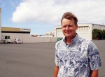 Bradley Pacific executive vice president and general manager Shaen Tarter stands on the ramp at the FBO chain's Honolulu facility. Though the stiff trade winds wreak havoc with his hair, they keep the Hawaiian Islands a constant 75 to 85 degrees F year-round. Because it is so temperate, transient aircraft are parked on the ramp at its six Hawaiian FBOs, and only Bradley's Honolulu facility even has a hangar.